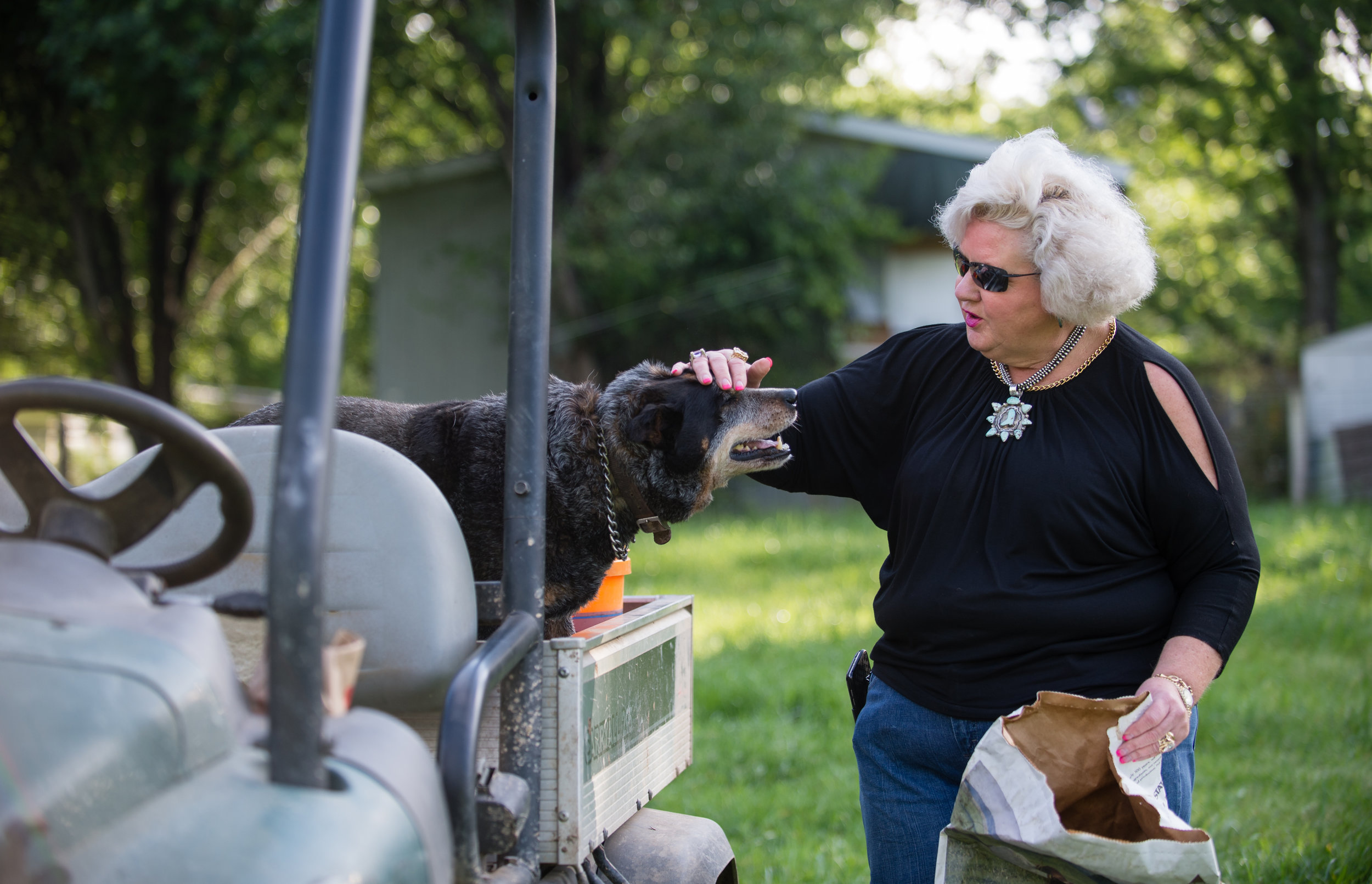 Ann Jones is a equine professional and cattle rancher with property in Georgia and Oklahoma. She's shown here on her farm, Jones Cutting Horses, with her dog Conway in Flowery Branch, Ga. in April 2017.