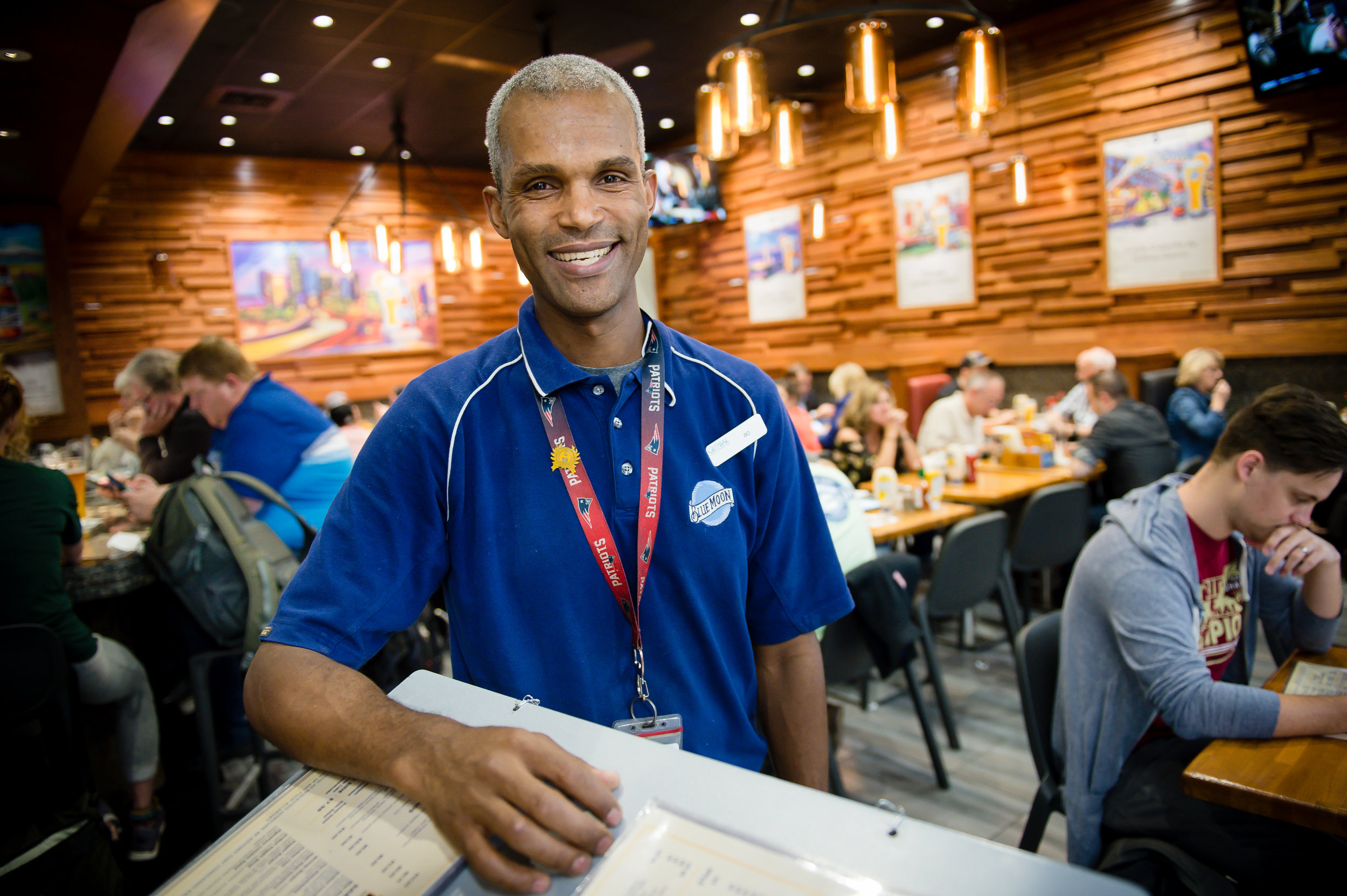 Bo Peterson, server and shift lead at the Blue Moon Brewhouse, poses for a photo at the Concourse B restaurant at Hartsfield Jackson Atlanta International Airport Friday, 28 Sept. 2018.