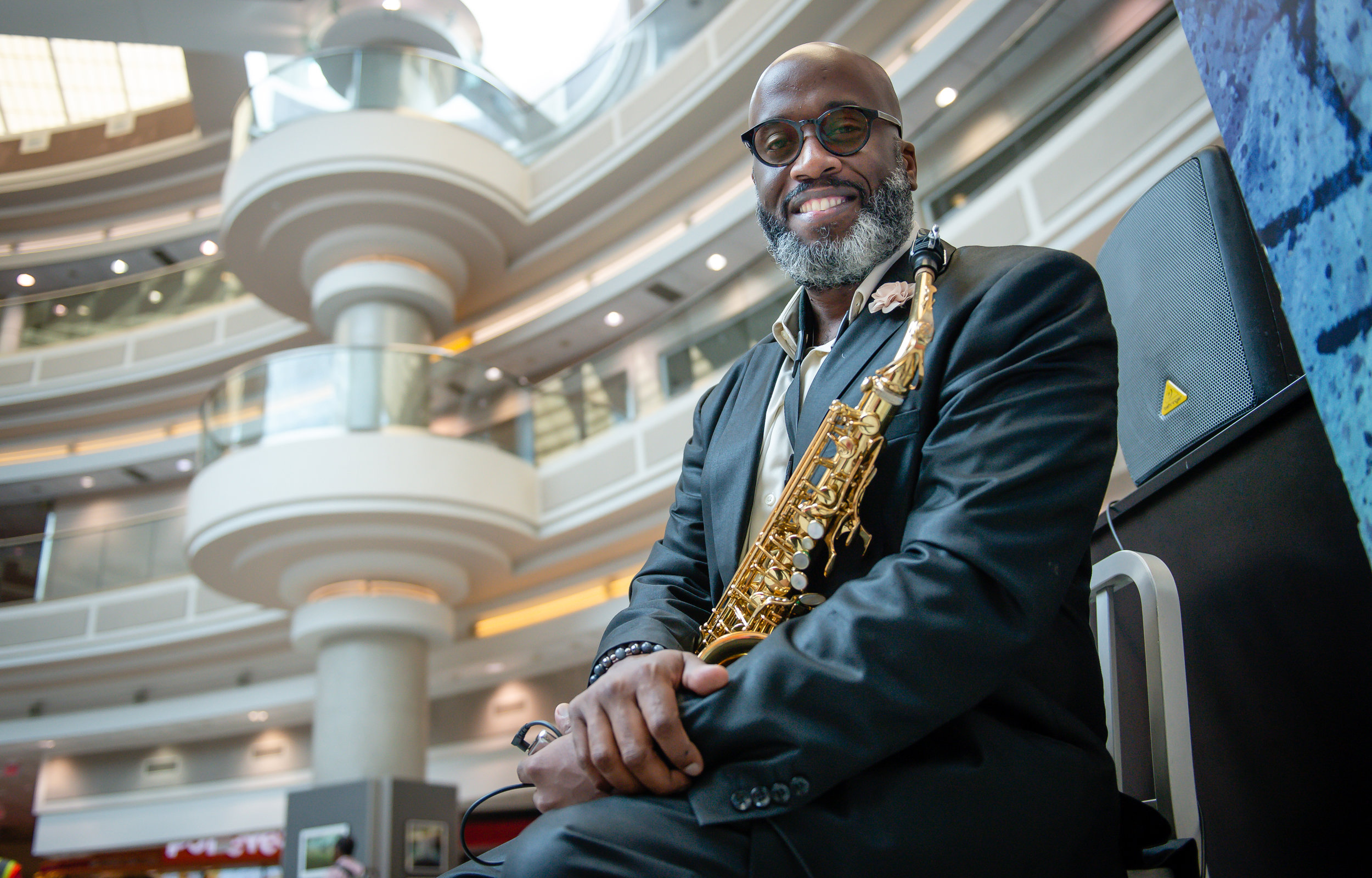 Musician Ron James poses for a photo with his saxophone during a break from performing in the atrium at Hartsfield Jackson Atlanta International Airport Friday, 28 Sept. 2018.