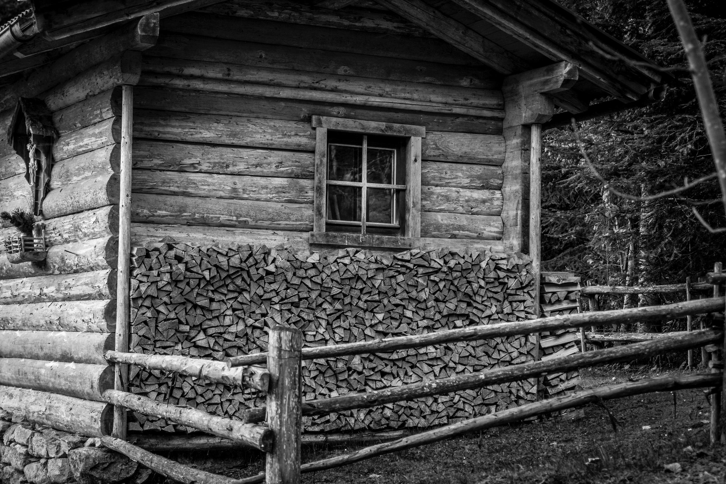 alpine hut woodpile.jpeg