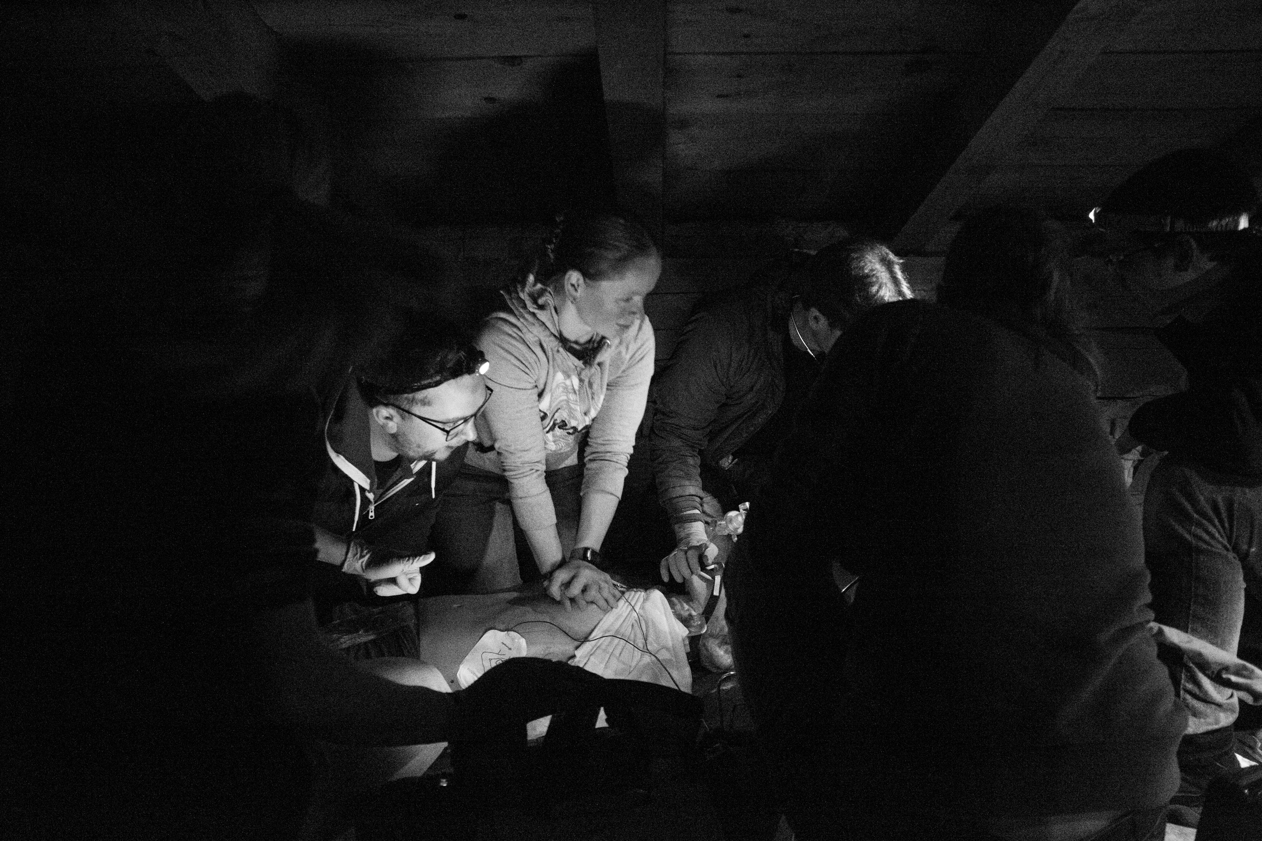Training with the  Red Cross  and the  Mountain Rescue , in the dark in an attic! Shot with Canon 6d with Tmron 28-75 f/2.8 at 1/80 sec f/4.0 ISO 8000