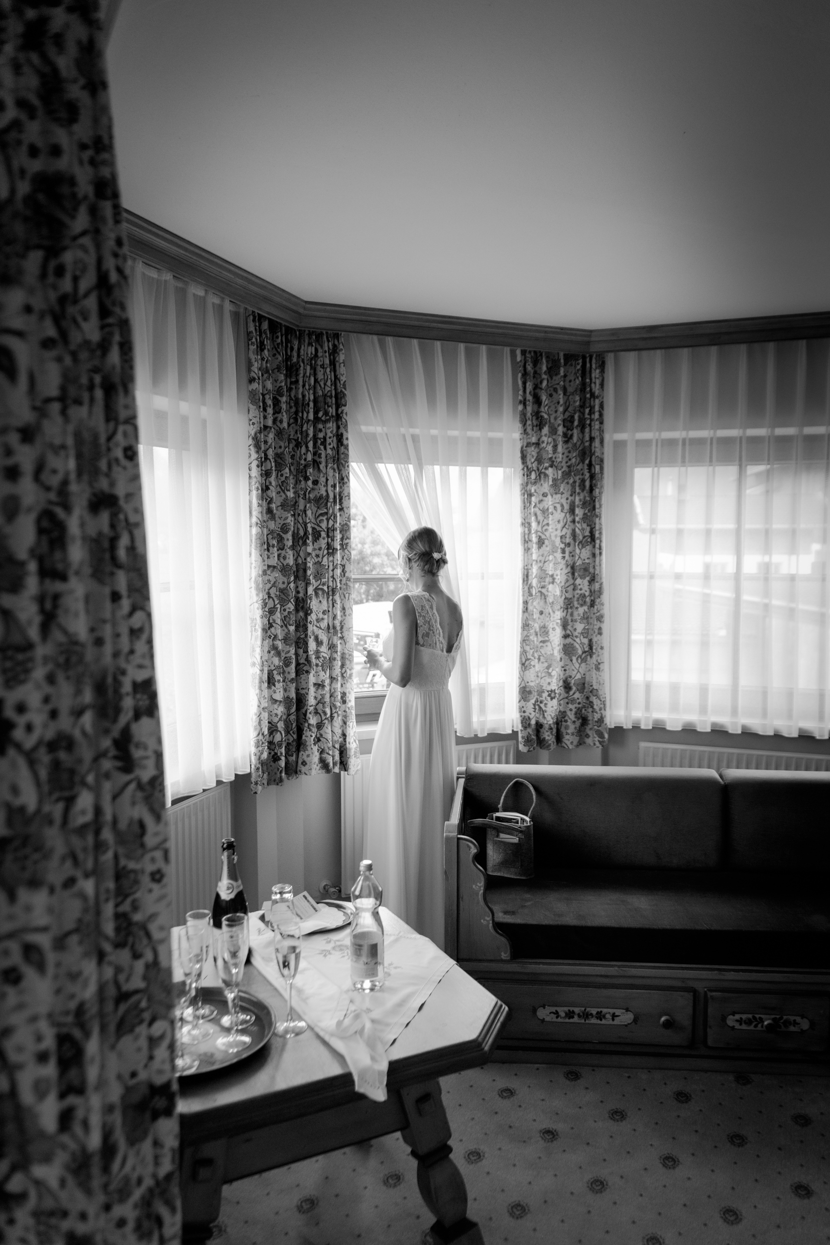 the bride waiting for her carriage to take her to the wedding. Shot with Canon 6D with Tamron 28-75mm f/2.8 @1/200 sec f/3.2 ISO 1600