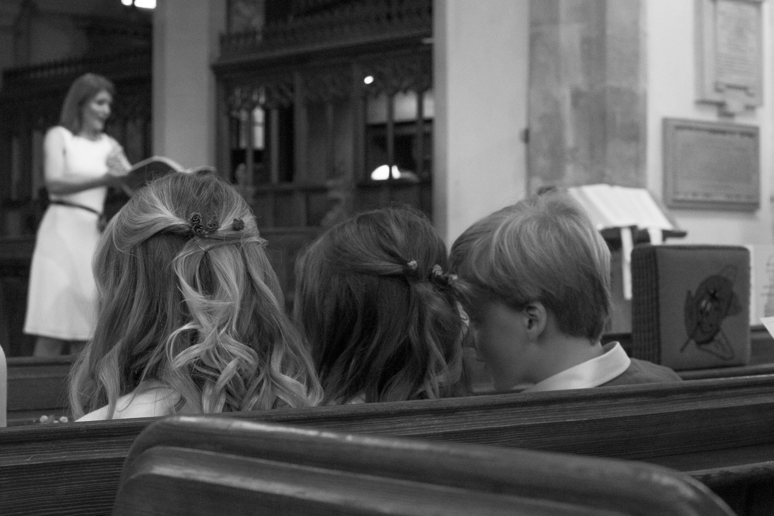 whispering at the wedding