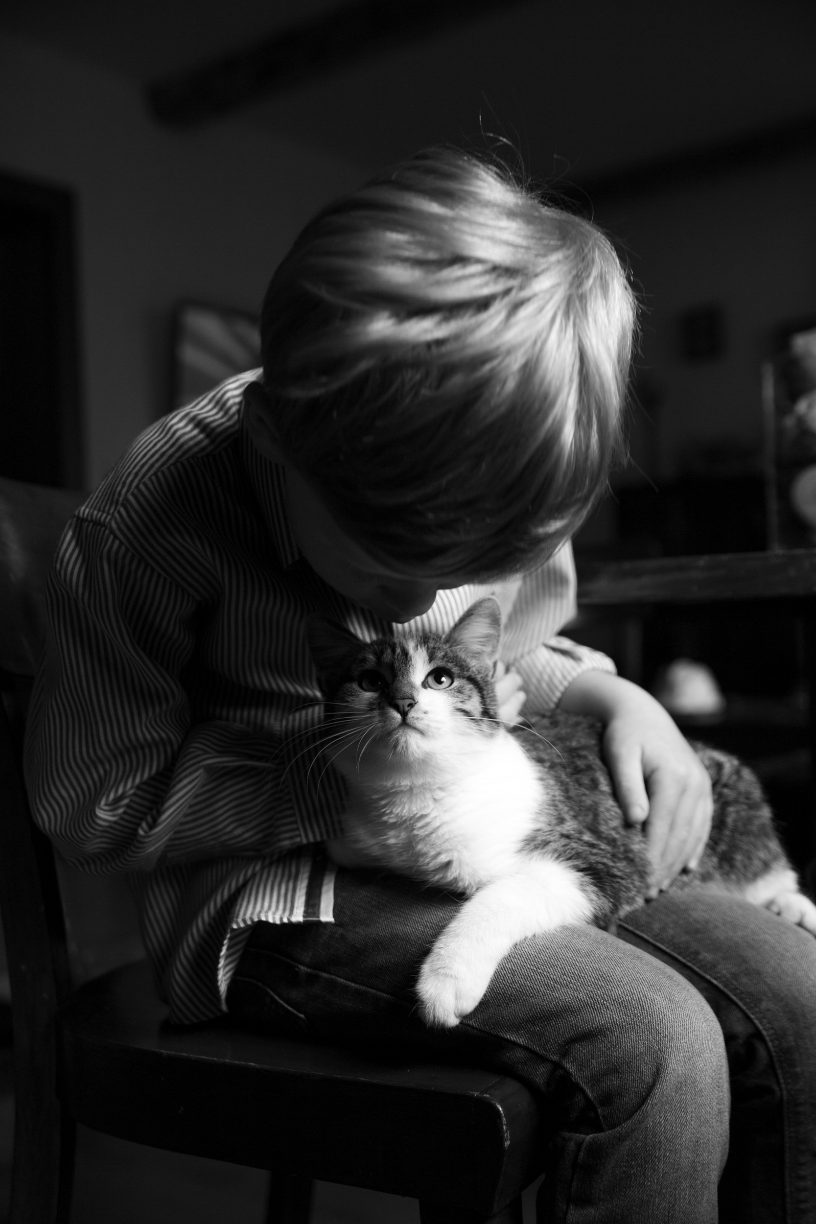 My eldest with Luna, one of our cats.