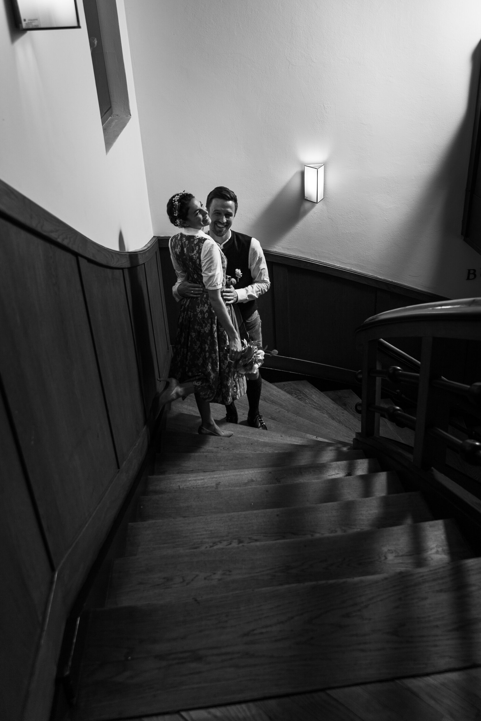 A portrait session on the stairs after a wedding at the Standesamt (registrar) in Mayrhofen