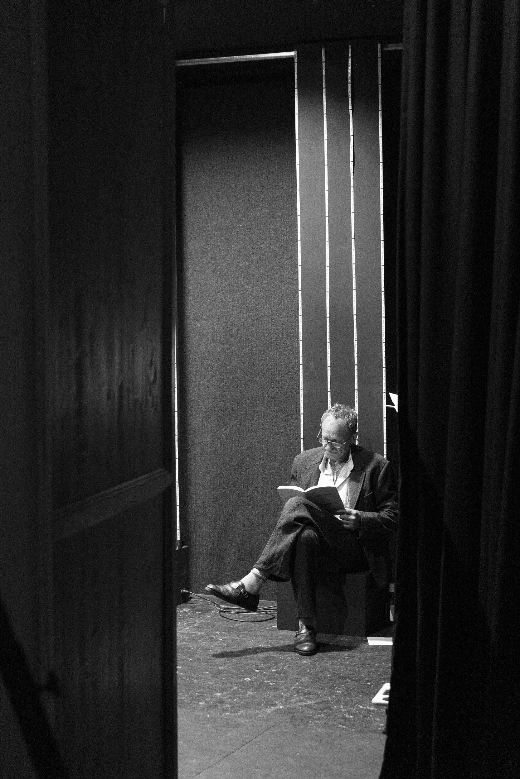 One of the actors at the local amateur dramatics society just catching up on his lines during a rehearsal.