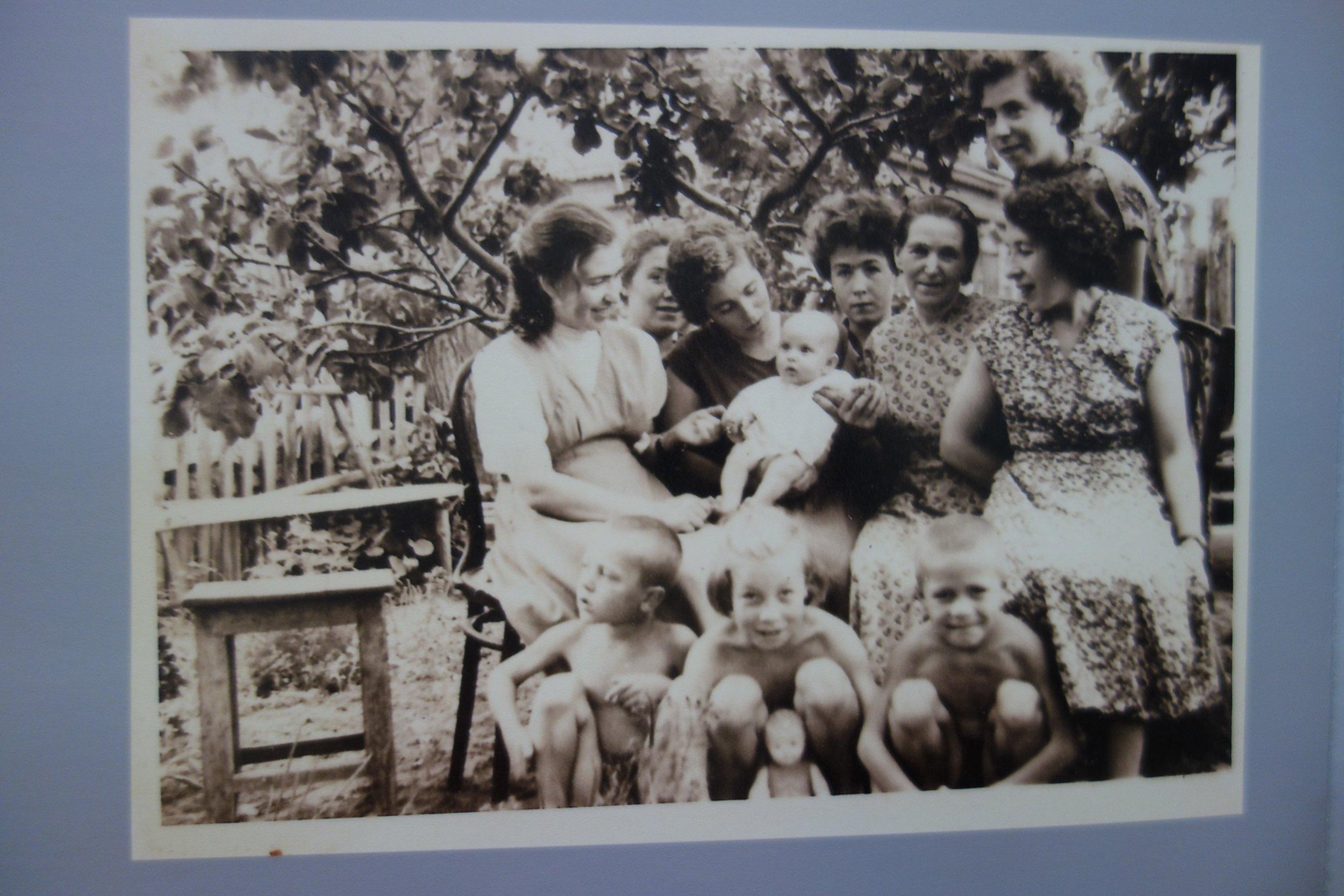 3 generations: My grandmother Polya, her daughters Masha, Liza, Lyuba, Valya, Ira Zoya (my mother, top right) and their children