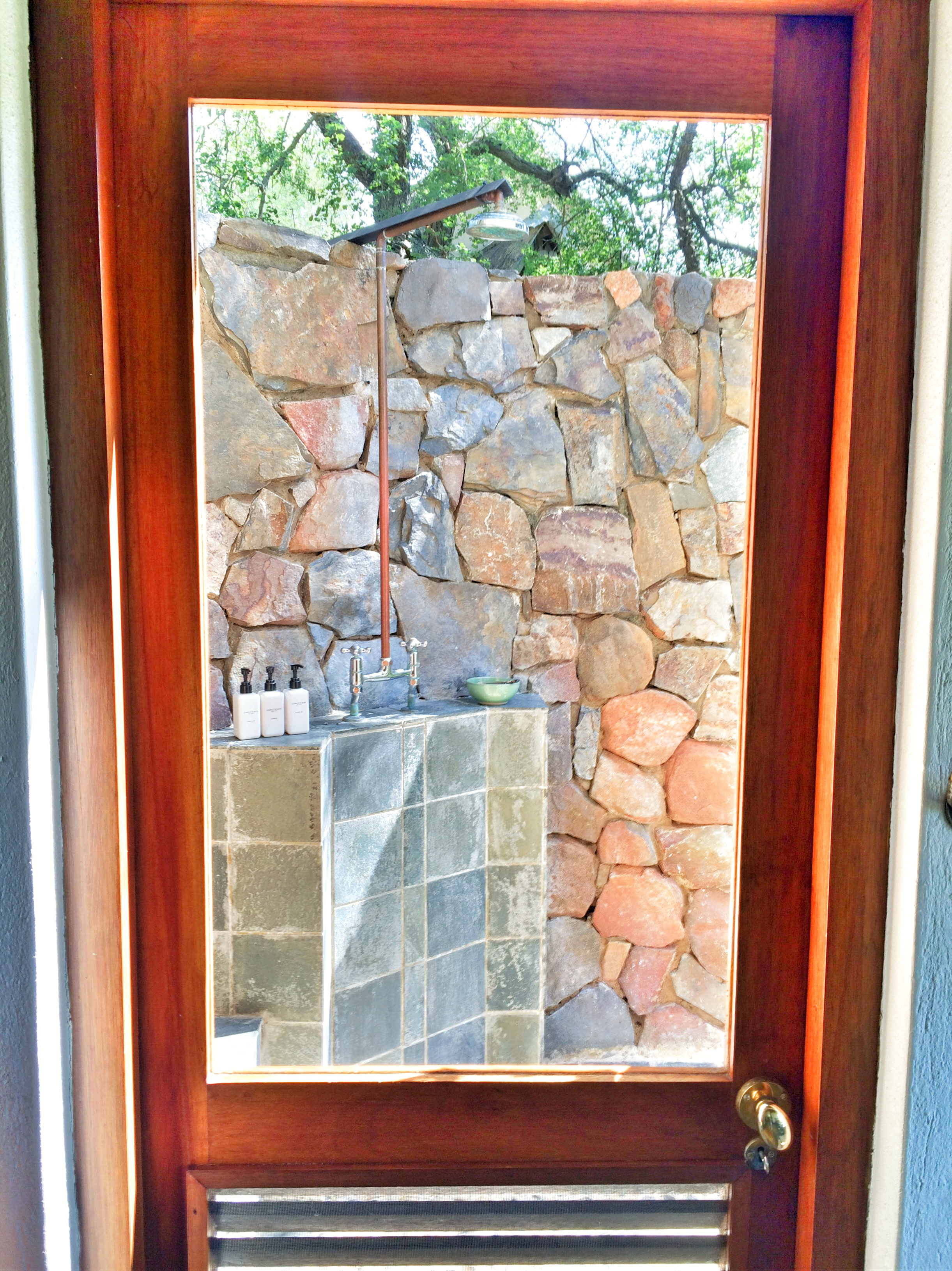 Private outdoor shower at a Thornybush Game Lodge room.