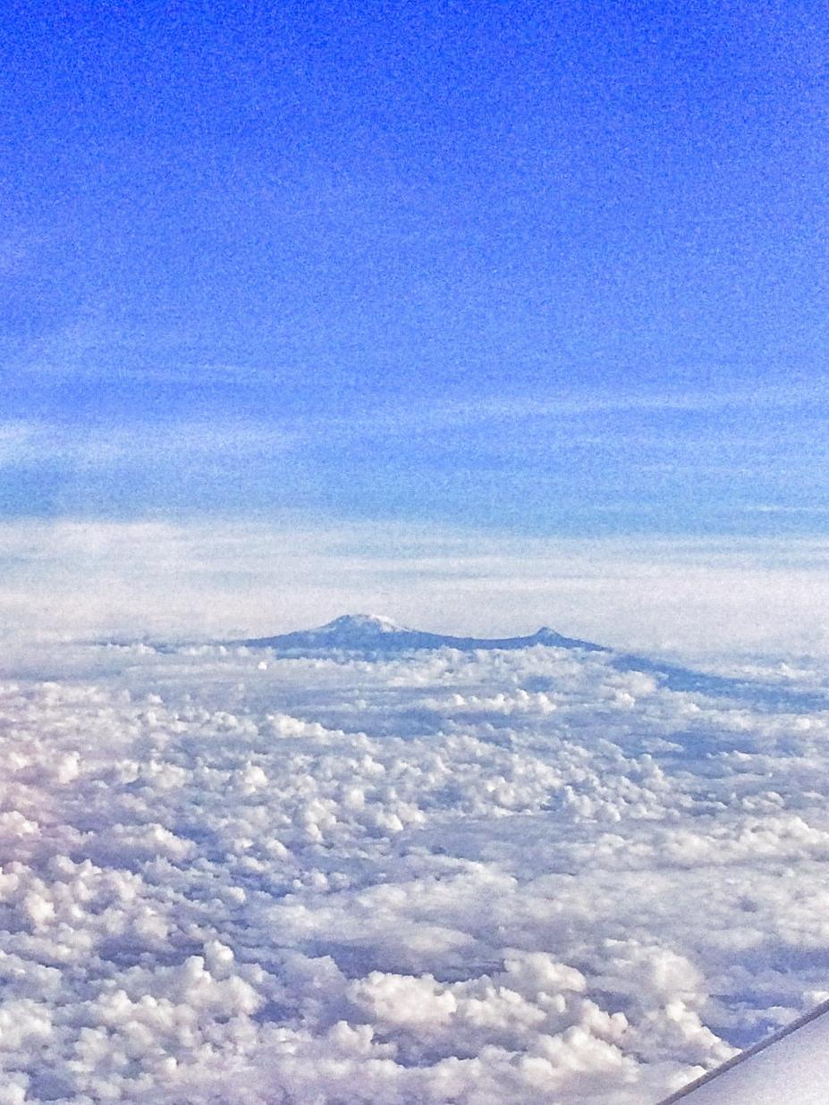 Mount Kilimanjaro outside the window of our plane, en route to the Serengeti