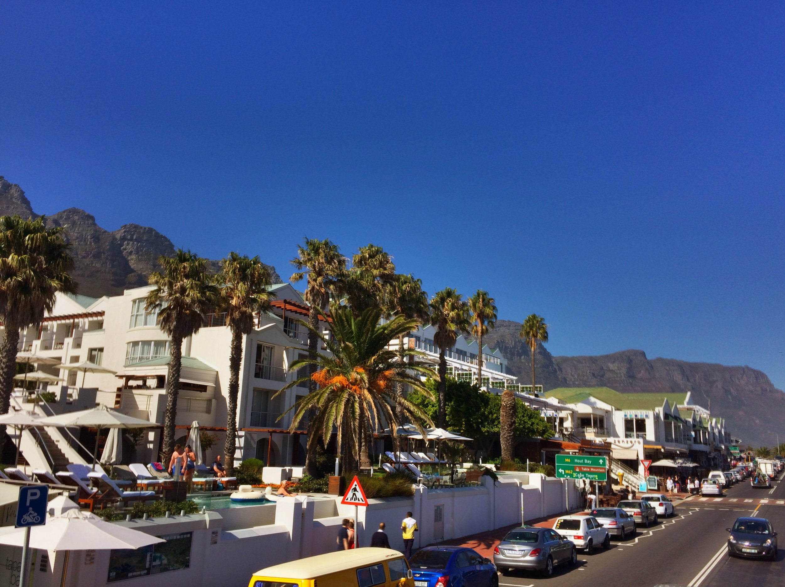 Camps Bay - an affluent area of Cape Town. Very beach community feel with stunning mountain scenery all around.