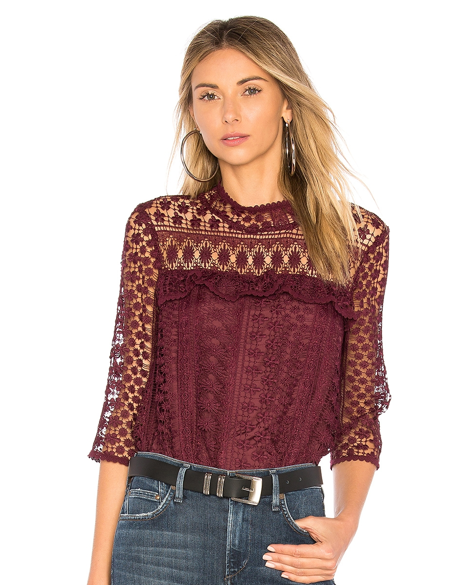 SHEER FACTOR - I love that this top has a high neckline but balances the more modest silhouette with a playful sheer overlay.