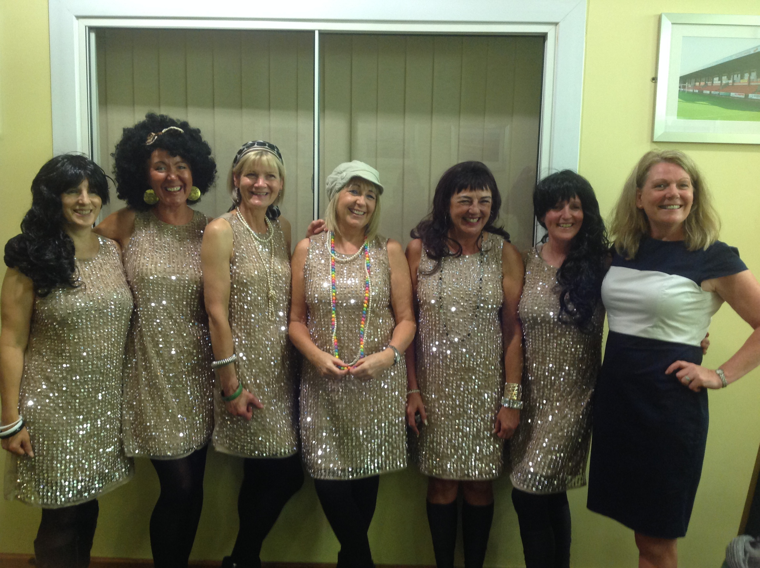 Bernie (2nd from right) and her lovely friends at the 70's night