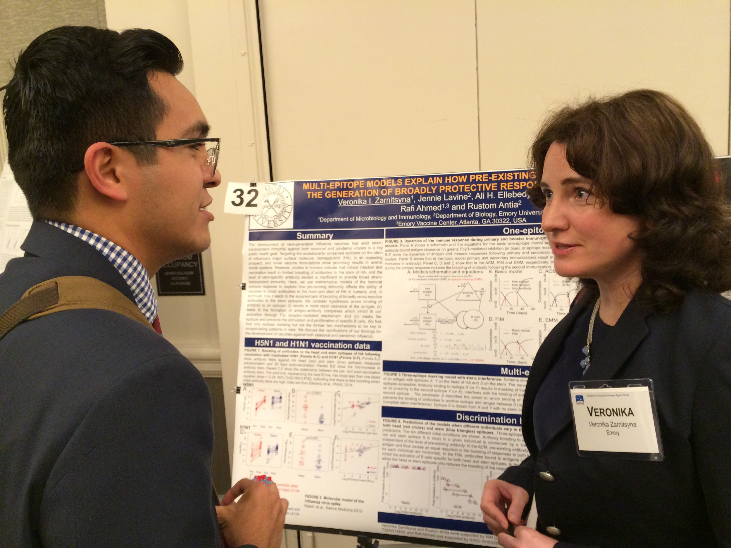 Student Ivan Solis speaking with Veronika Zarnitsyna (CIDID/Emory).