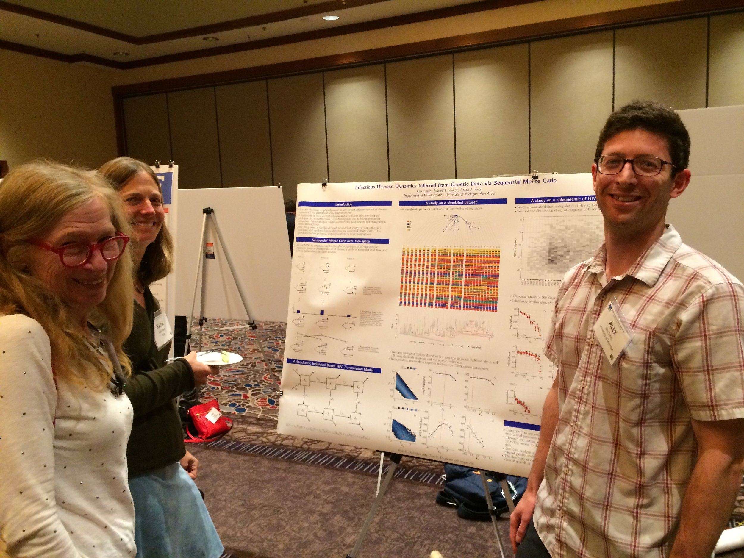 Alex Smith discussing his poster with Betz Halloran and Katia Koelle.