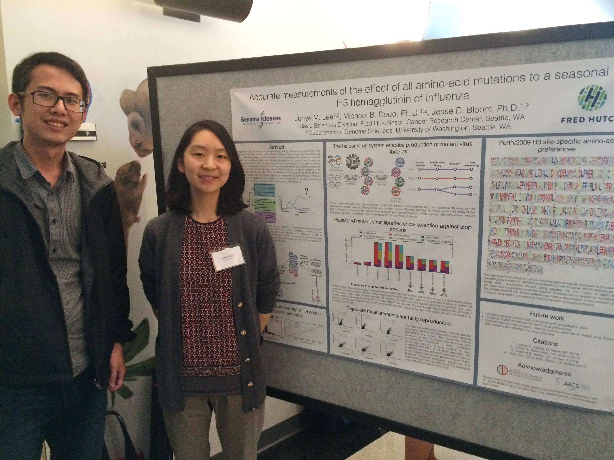 Juhye Lee (Fred Hutch/University of Washington) discussing her poster with Tim Tsang (University of Florida).