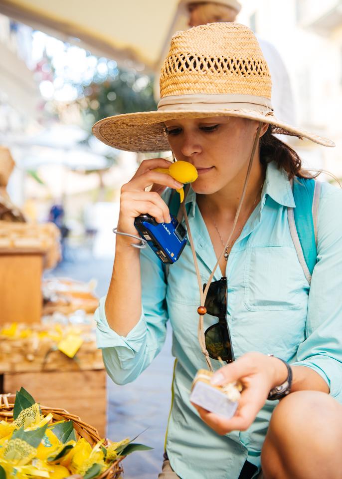 Chelsea smelling the fresh lemon soap.