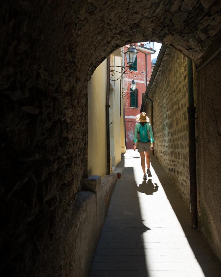 Chelsea wandering the narrow streets of Manarola.