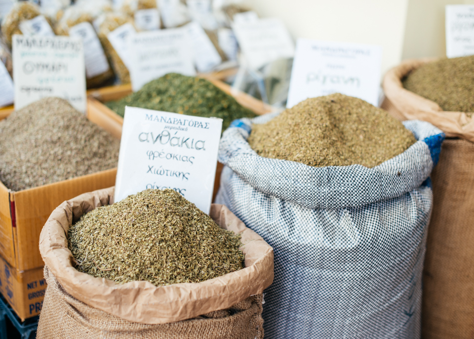 Sacks of herbs line the booths.