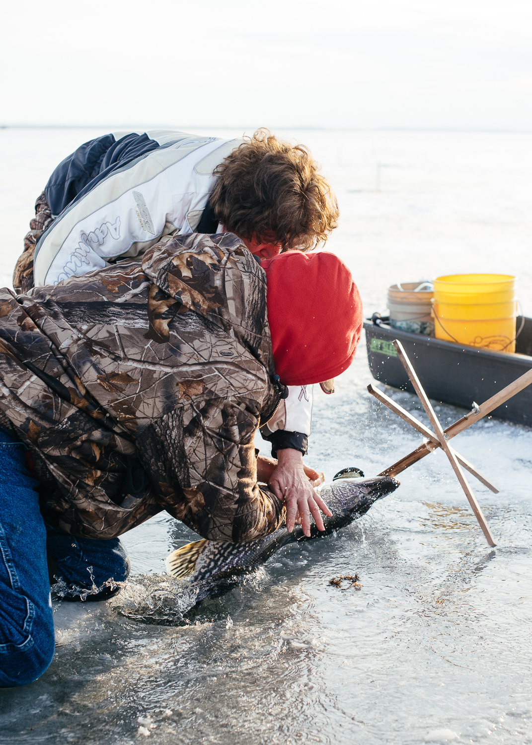 Bob and his wife struggle to keep the Northern Pike from slipping back into the water.