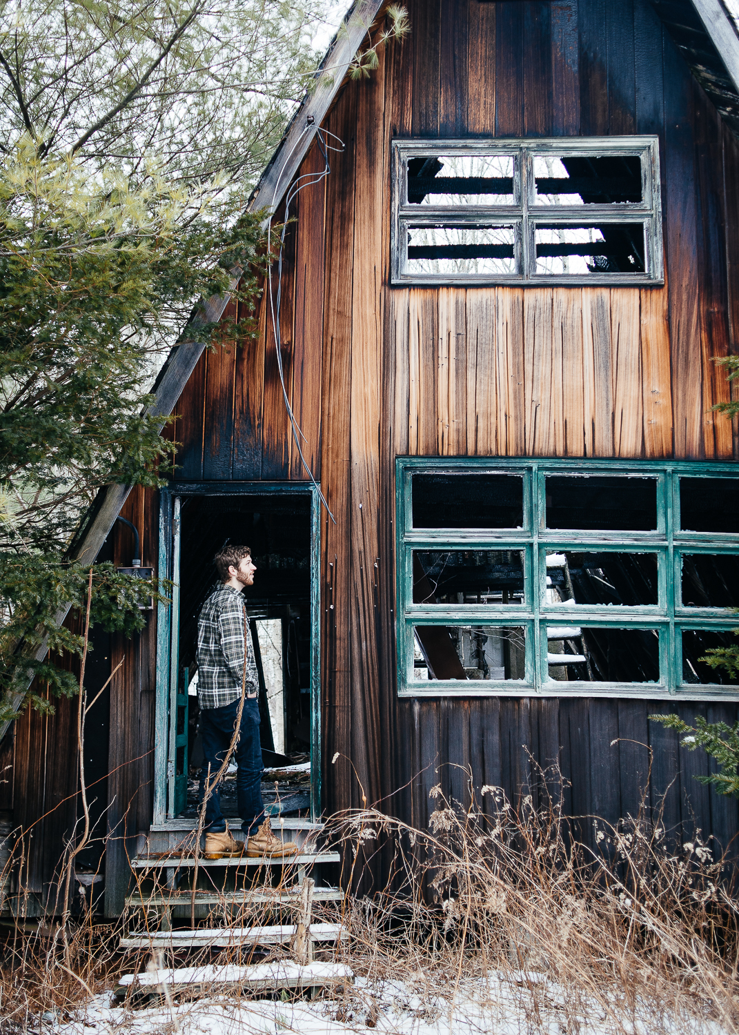 Adam checking out a burned out A-Frame house.