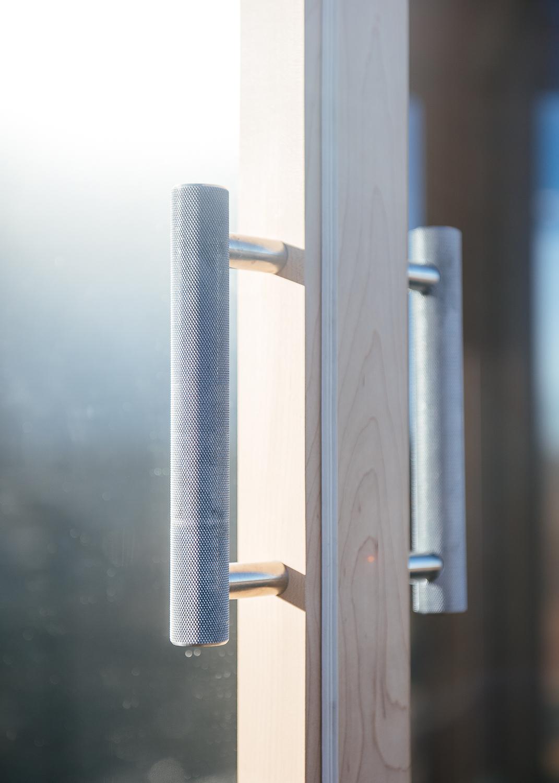 Stainless steel door handle.