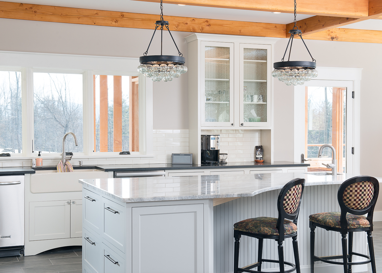 Crisp white kitchen with custom marble island.