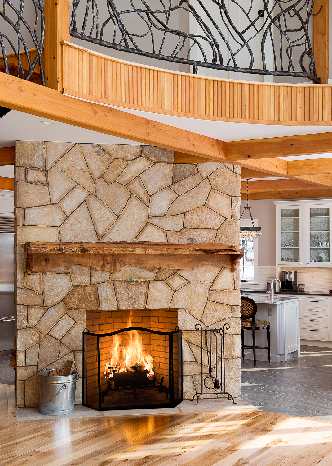 Fireplace separating the living area from the kitchen.