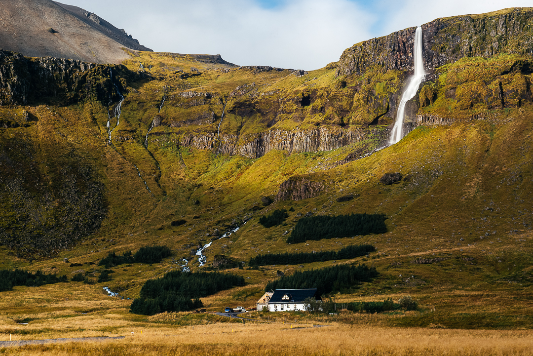 Farm powered by rushing stream of a massive waterfall.