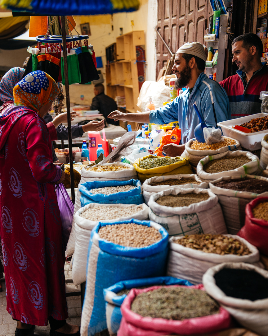 Vendor selling fresh nuts and spices.
