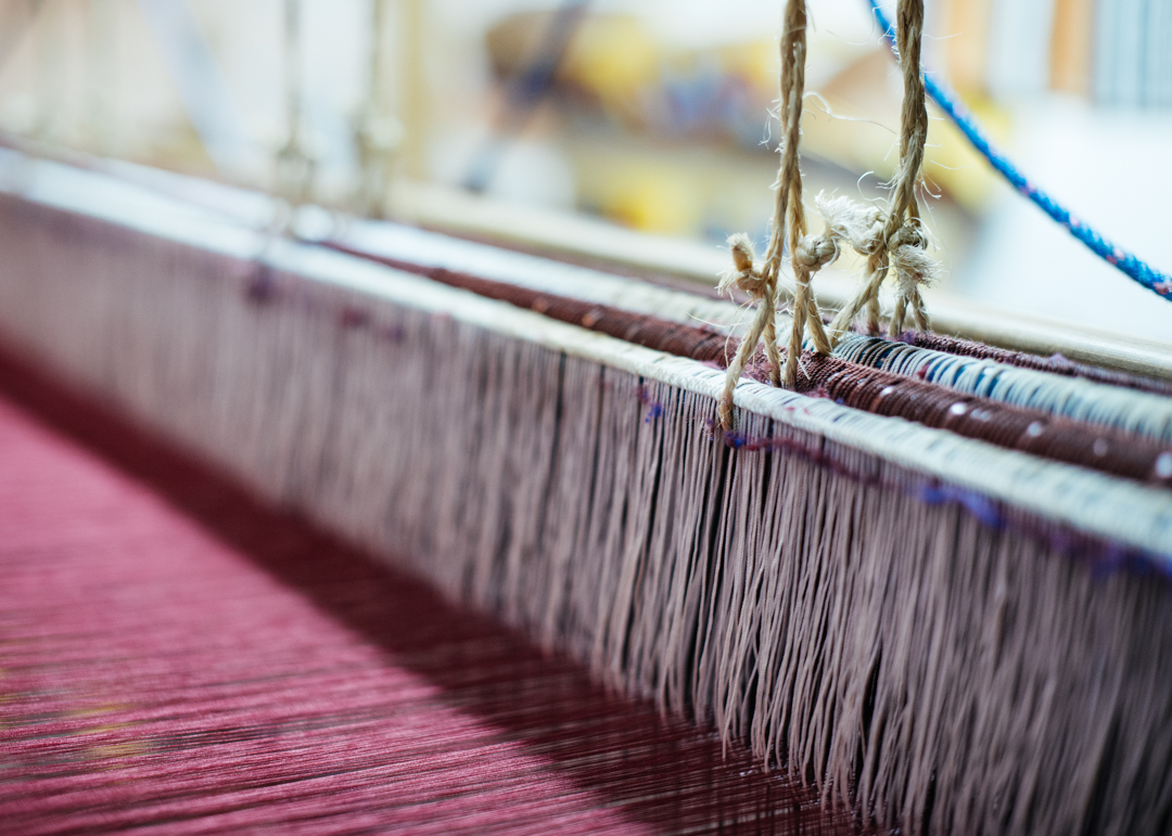 A loom in the process of making a blanket.