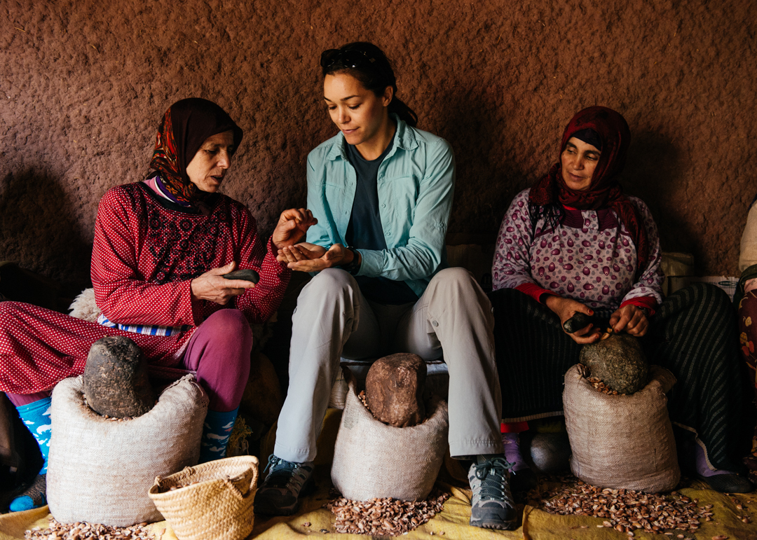 Chelsea learning how to crack the argan seeds.