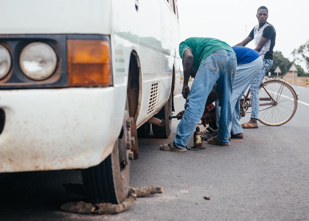 Fixing a flat tire.