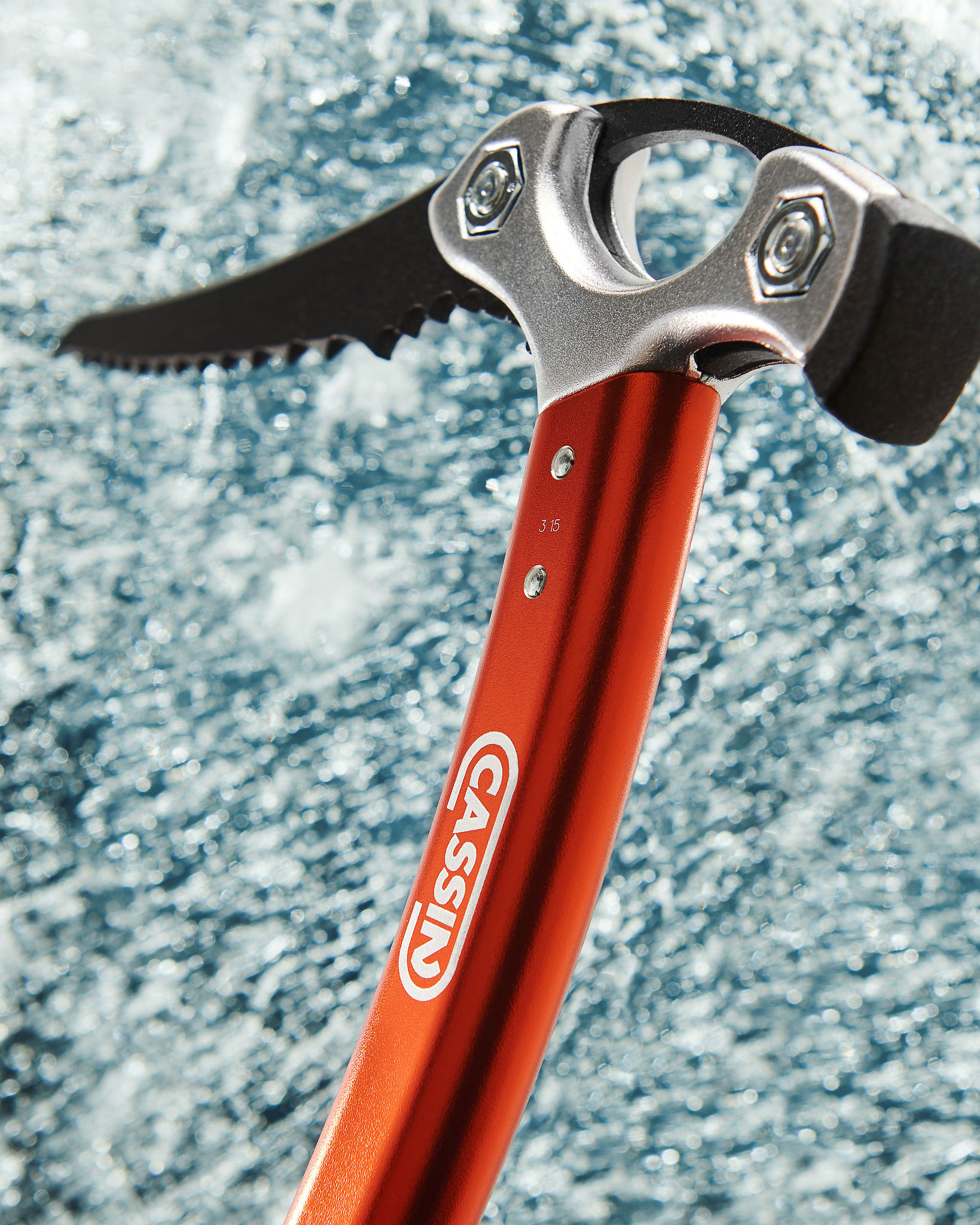 Detail of the ice axe striking the ice.