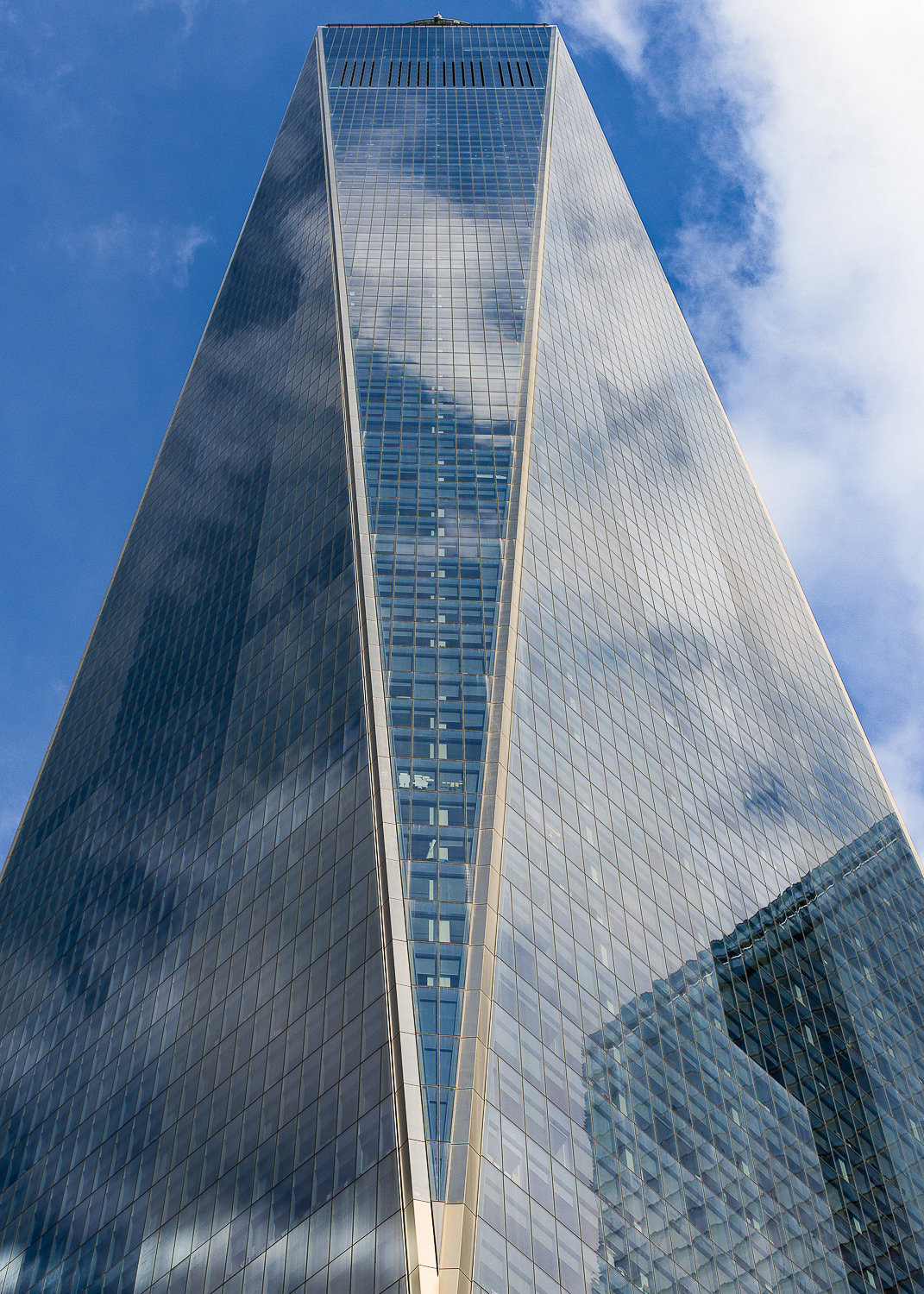 One World Trade Center - architect - David Childs. The new tower was completed in 2013 after the terrorist attack on 9/11/01 took down the original building. It is the tallest skyscraper in NYC at 1,776 ft, a deliberate reference to the year when the Declaration of Independence was signed.