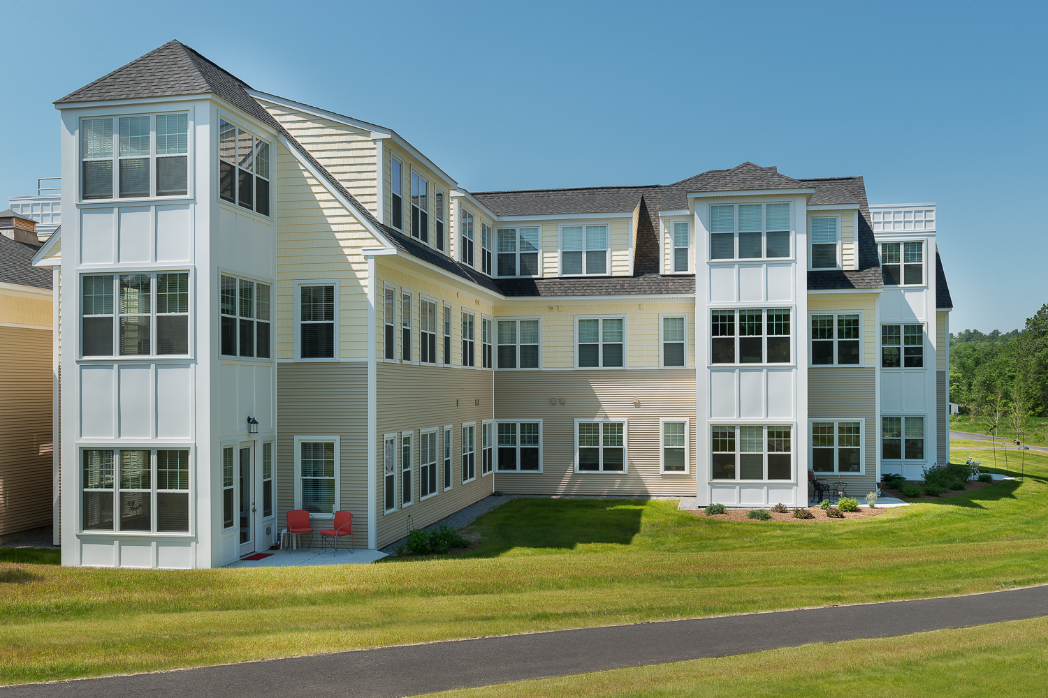 Rear exterior of independent living and walking path.