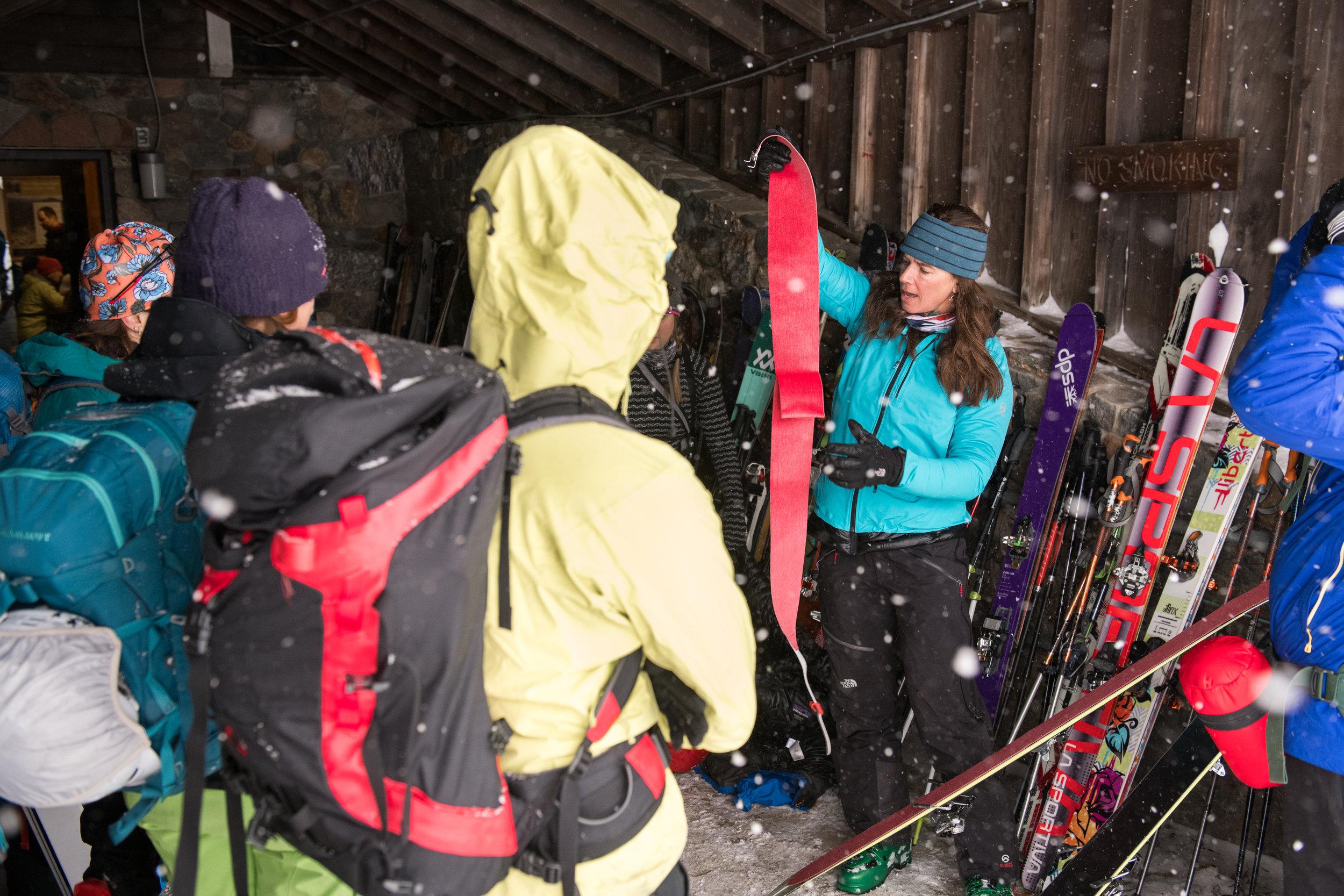 Kit applying skins in the warming hut.