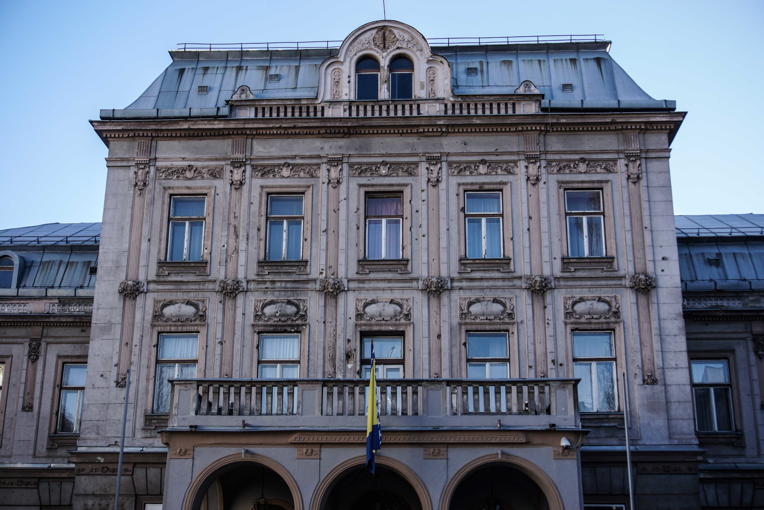 Bosnian Cultural Center with bullet holes throughout the facade