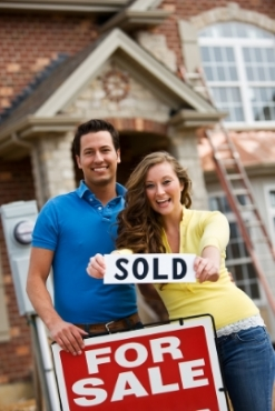 shutterstock couple sold house sign.jpg