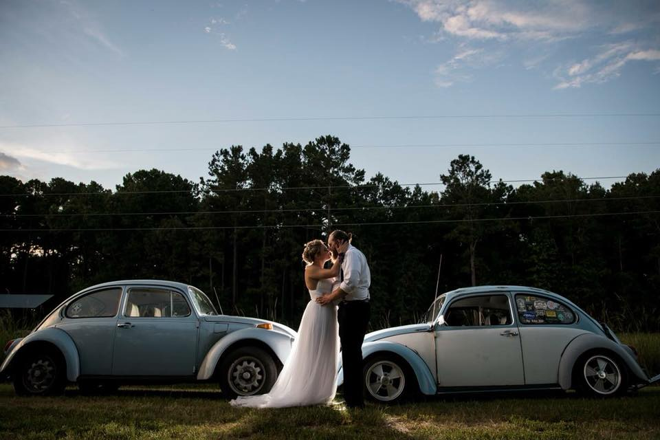 Couple Details: -  Nicole and Nate started dating after realizing that they both shared the same love for old school cars!! (How CUTE are those Beetles?!) The bride's dress was her grandmother's, and she had it altered to her liking.
