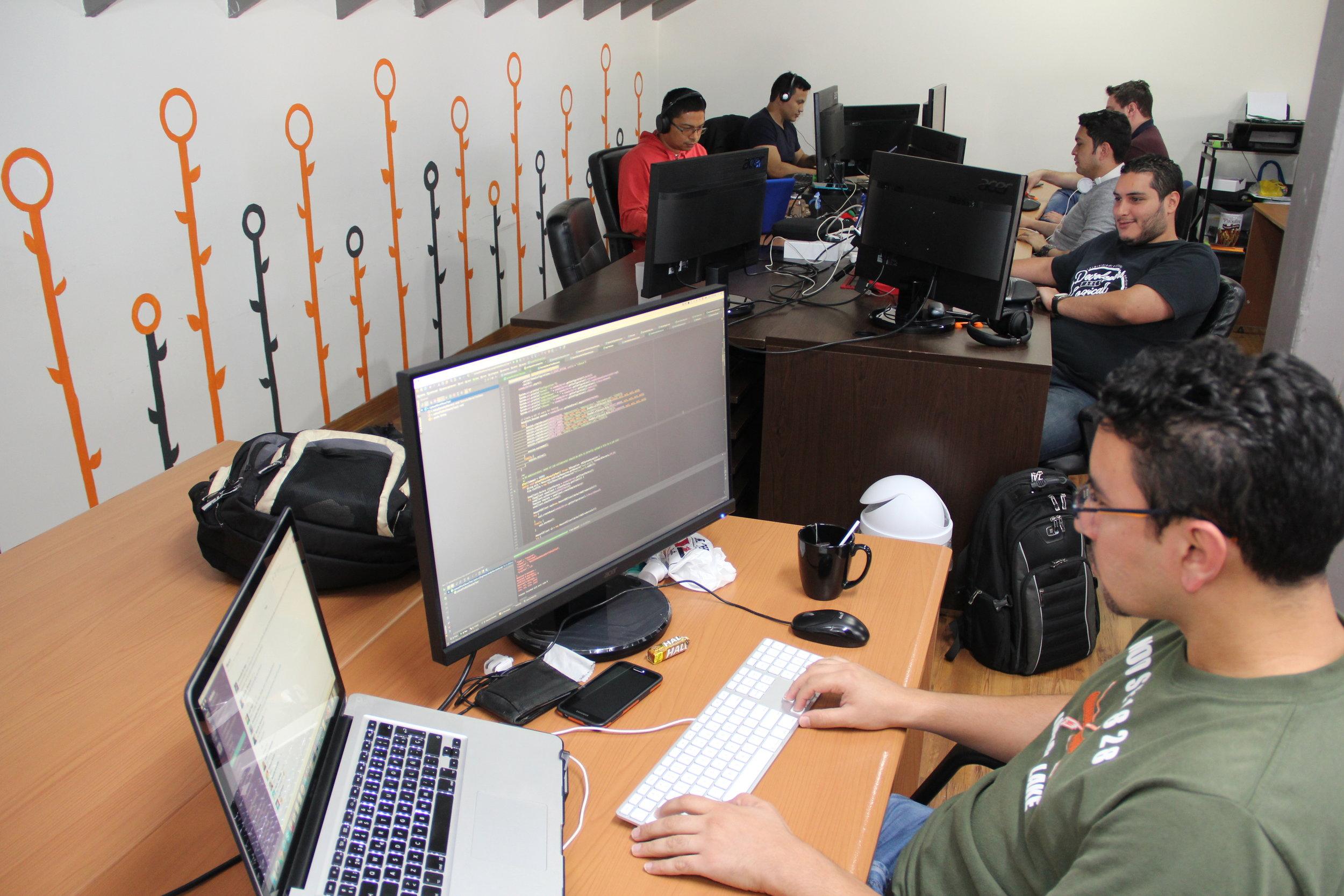 Software-developers-working-together-on-computer.jpg