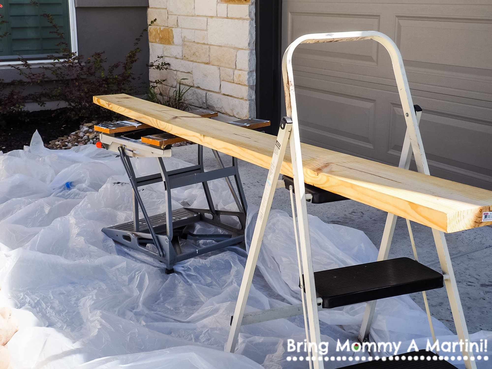 "My very fancy set-up for staining: a workshop table and a step ladder served as my ""table."""