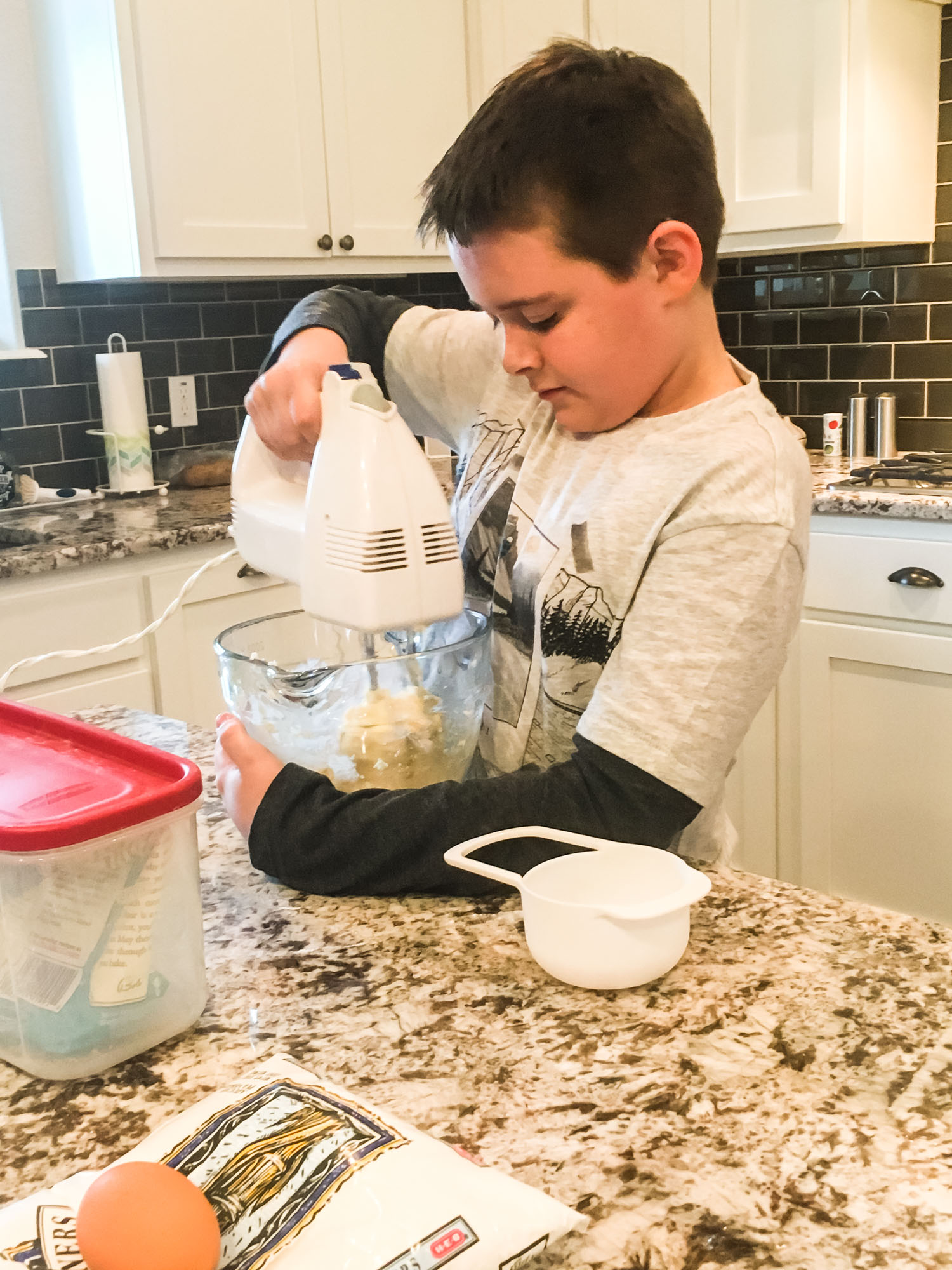 If he learns nothing else in life, at least he can operate a mixer!