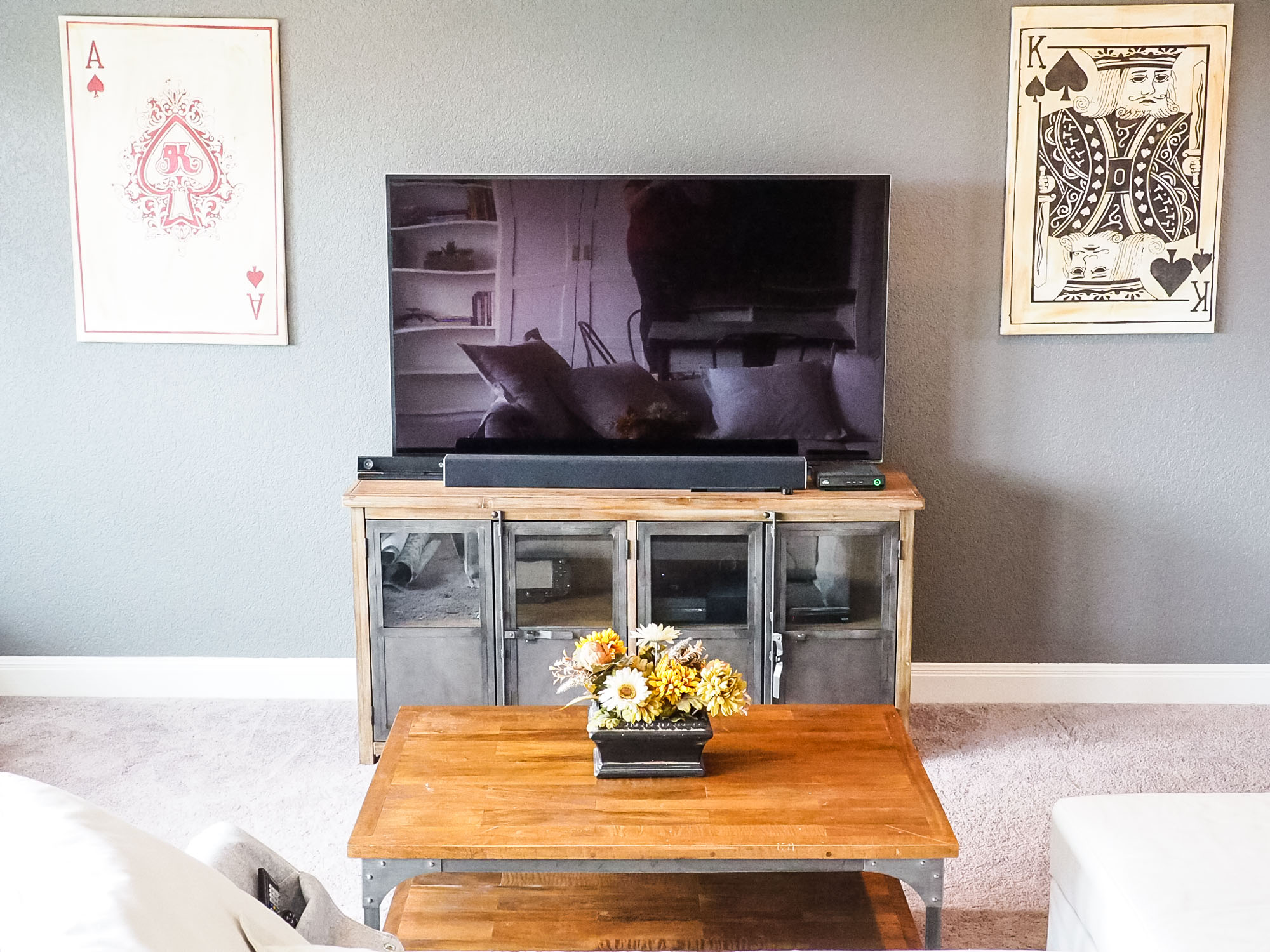 You can see in the TV reflection how sleek the IKEA stuff is on the opposite wall. I love the balance of these rustic/industrial pieces, and how the wood warms up the space.