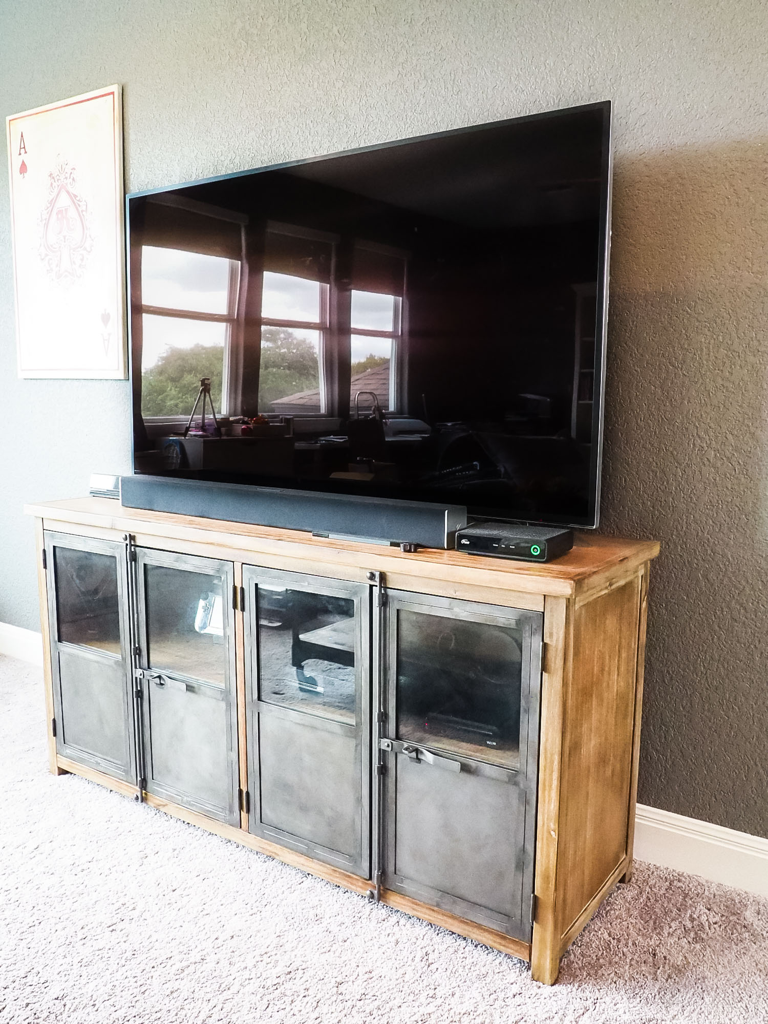 This media unit has a unique latch closure that is industrial and adds character. I love it! (It's the  Langley Storage Cabinet  and it's 40% off right now! Use code FURNDEAL at checkout.)