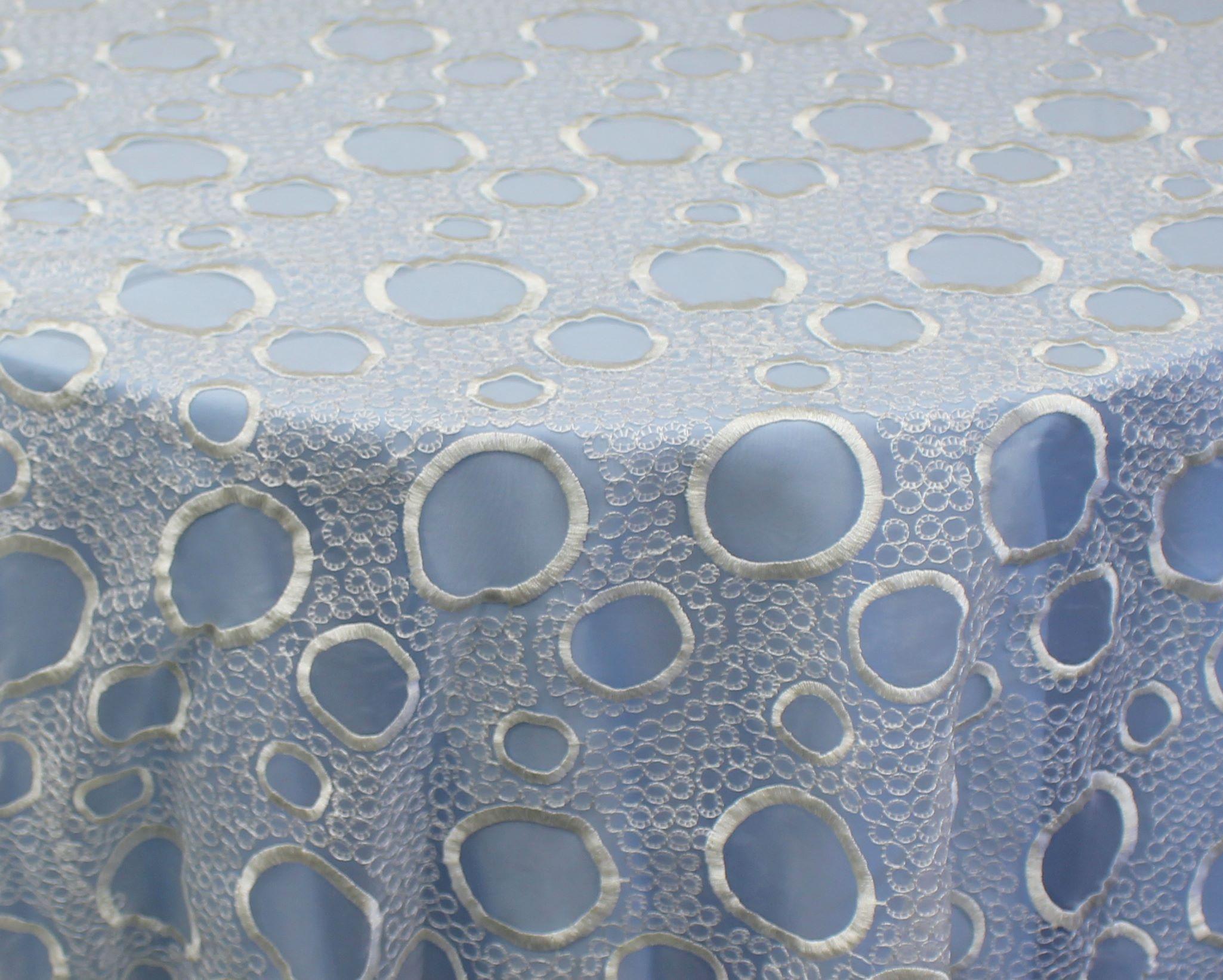 White Bubbles Overlay over Light Blue Satin
