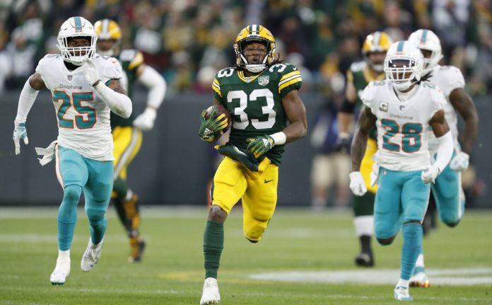 Jones-Helps-Packers-Run-Away-for-31-12-Win-Over-Dolphins-696x431.jpg