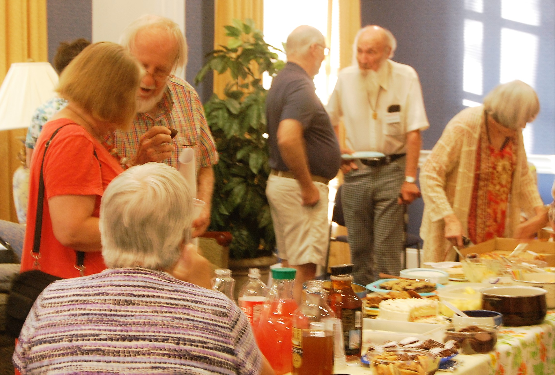 Members and guests mingle over snacks at the annual fall open house.