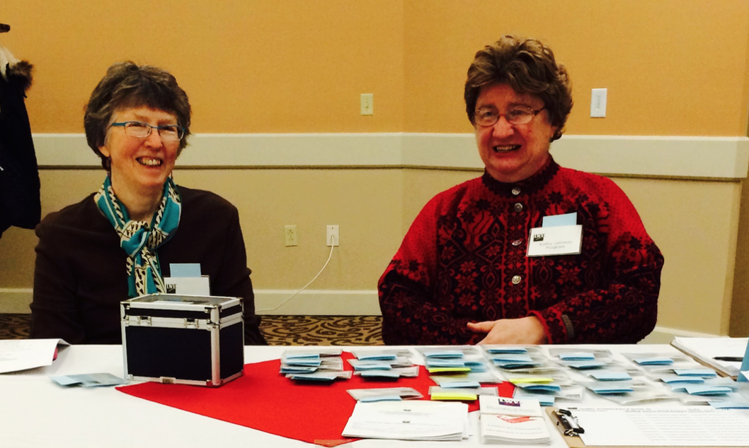 Mary Anglim with Kathy Johnson at the 2015 Lively Issues Luncheon registration table.