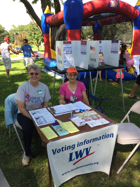 In the dappled shade of locust trees, with a gentle breeze, League SRDs answered questions about registration, polling locations, name changes, and homeless voting.