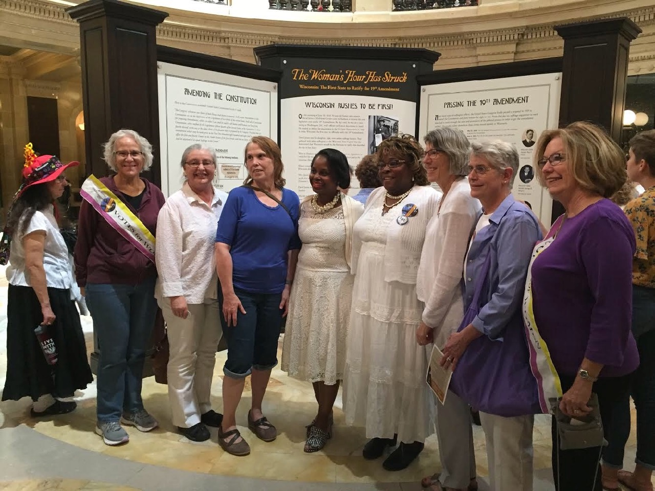 League and Delta Sigma Theta members gather in the rotunda to celebrate woman suffrage!
